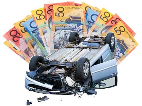 A completely smashed and turned over car after an accident being bought for cash.
