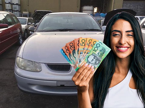 Women showing us the money she earned after selling her unwanted Holden to us.